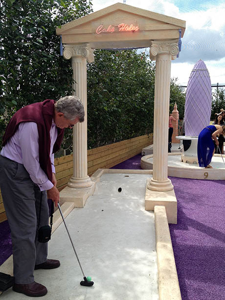 Dad playing Bompas and Parr minigolf