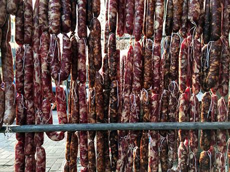 Sausages hanging on street 460