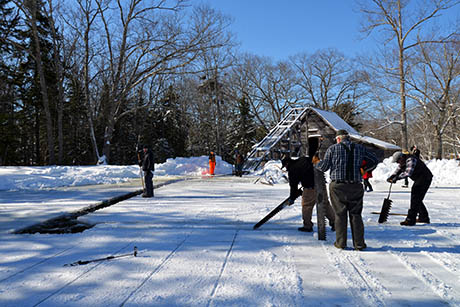 21 Sawing first blocks ice house in background