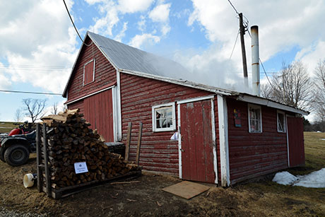 16 Soukup sugar shack and woodpile 460