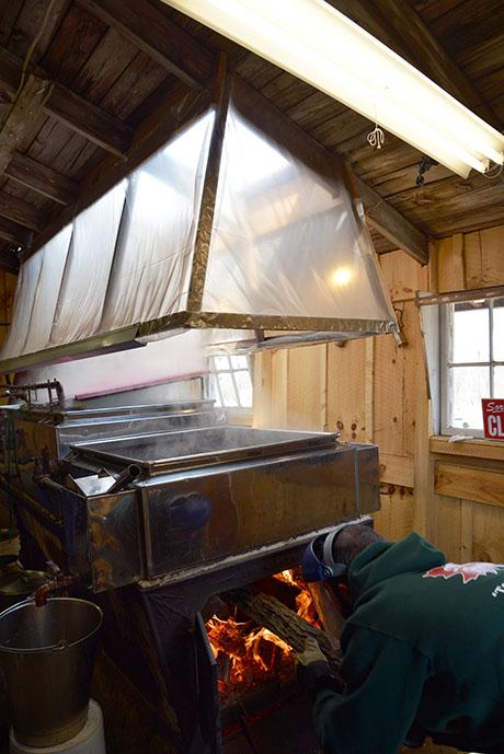5 Loading the wood-burning stove at Soukup 460