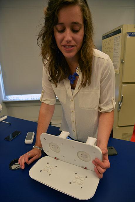 Rachel displays interior of oPhone 460